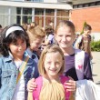 Foto de Stock  : Happy children in front of school, o