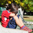 Sad child in the park, outdoor, summer t - Stock Photo