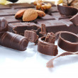 Chocolate, table, pieces, on white backg - Foto Stock