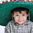 Foto Stock: Cute kid with mexichat on head