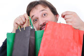 Young man with bags for shopping — Stock Photo