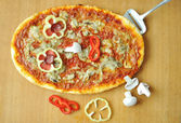 Prepared pizza with many colors on and s — Stock Photo