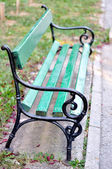 Green chair in park — Stock Photo