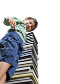 A little cute kid on many books — Stock Photo