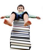 A little cute kid and large number of books — Stock Photo