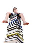 A little cute kid and large number of books as a — Stock Photo
