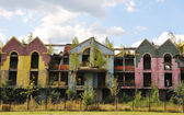 Destroyed building, many colors, sky and clouds — Stock Photo