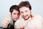 Two successful young man with thumbs up — Stock Photo
