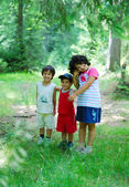 Children in forest, very greenful scene — Stock Photo