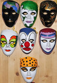 Many different masks on wooden wall — Stock Photo