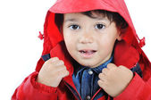 Very cute child in autumn winter fashion clothes — Stock Photo