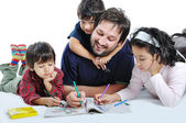 Happy family with several members in education p — Stockfoto