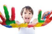 Malé roztomilé dítě s barvami na bílém pozadí — Stock fotografie