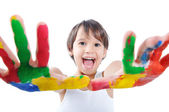 A little cute child with colors on white — Stock Photo