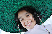 A little cute girl with hat on head — Stock Photo