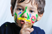 A little cute child with several colors — Stock Photo
