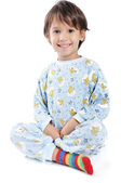 A little beautirul kid in pajamas — Stock Photo