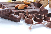 Chocolate, table, pieces, on white backg — Stock Photo