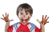 Weinig schattige jongen met chocolade op gezicht een — Stockfoto