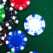 Casino chips on green felt — Stock Photo #1601871