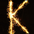 Royalty-Free Stock Photo: Letter K made of sparklers isolated