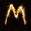 Letter M made of sparklers isolated — Stock Photo