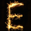 Letter E made of sparklers isolated — Stock Photo