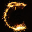 Letter C made of sparklers isolated — Stock Photo