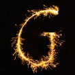 Letter G made of sparklers isolated — Stock Photo