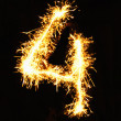 Digit 4 made of sparklers — Stock Photo