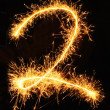 Digit 2 made of sparklers — Stock Photo
