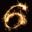 Digit 6 made of sparklers — Stock Photo