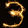 Digit 8 made of sparklers — Stock Photo