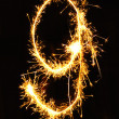 Digit 9 made of sparklers - Stock Photo
