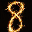 Stock Photo: Digit 8 made of sparklers