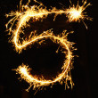 Digit 5 made of sparklers — Stock Photo