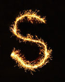 Letter S made of sparklers isolated — Stock Photo