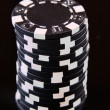 Casino chips on black background — Stok fotoğraf