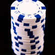 White casino chips on black background — Стоковая фотография