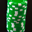 Stock Photo: Green casino chips on black background