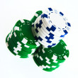Stacks of casino chips isolated on white - Stock Photo