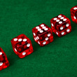 Row of dice on green background — Stock Photo #1631699