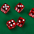 Five dice on a green background — Stock Photo