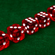 Row of dice on green background — Stock Photo #1631823