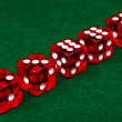 Row of dice on green background — Stock Photo