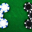 Casino chips on green felt — Stock Photo #1631945