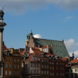 Zygmunt`s Column and old town in Warsaw - Stock Photo