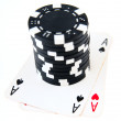 Pocket aces and stack of black chips — Stock Photo