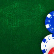 Casino chips on green felt — Stock Photo #1632386
