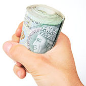 Hand and roll of polish Zloty on white — Stock Photo